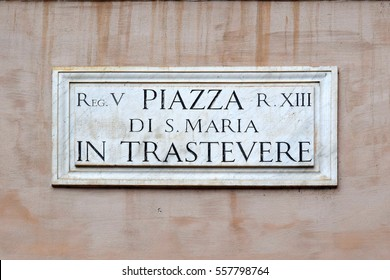 Piazza di S. Maria in Trastevere, street plate on a wall of old house in Trastevere district, Rome, Italy