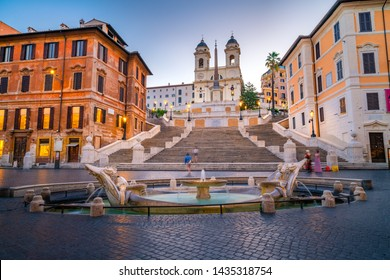 Piazza di Spagna square with Spanish Steps in Rome at night, Italy