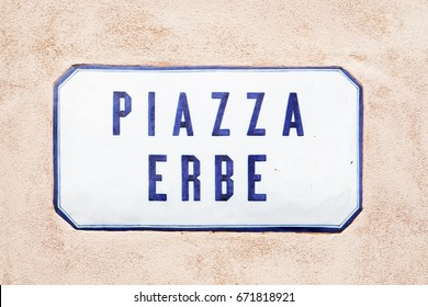 Piazza Erbe Street sign on the wall in Mantua, Lombardy, Italy
