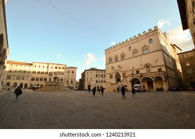 Piazza IV Novembre (the main square) with the Palazzo dei Priori and the main fountain at sunset in Perugia, Umbria