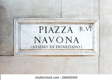 Piazza Navona sign on historic italian building in Rome