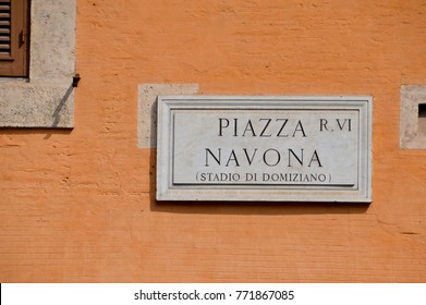 Piazza Navona sign on historic italian building in Rome, Italy