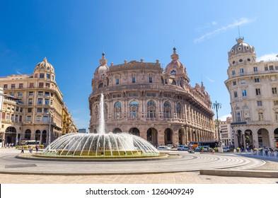 Piazza Raffaele De Ferrari square with fountain and Palazzo della Nuova Borsa Palace barocco style building in historical centre of old city Genoa (Genova) with blue sky background, Liguria, Italy