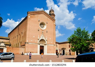Piazza San Francisco, Siena, Italy - May 24, 2011 : Brick Exterior of Basilica of San Francesco, with beautiful rose window ,marble symbols of four evangelists and coats of arms of Siena  and families