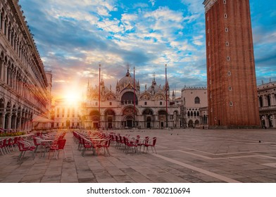 Piazza San Marco with the Basilica of Saint Mark and the bell tower of St Mark's Campanile after sunset - Venice, Italy