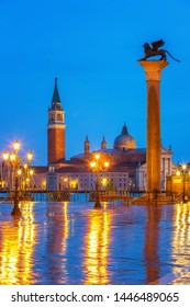 Piazza San Marco at night, view on venetian lion and san giorgio maggiore, Vinice, Italy
