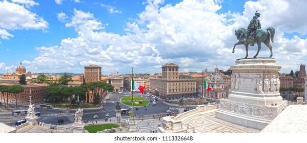 Piazza Venezia, view from Vittoriano (The Altare della Patria). Panorama of Rome. Italian flags. Statue of Victor Emmanuel II