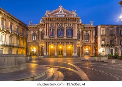Piazza Vincenzo Bellini and opera house grandiose theater Massimo Bellini in Sicilian Baroque style in the night lighting, Catania, Sicily, Italy
