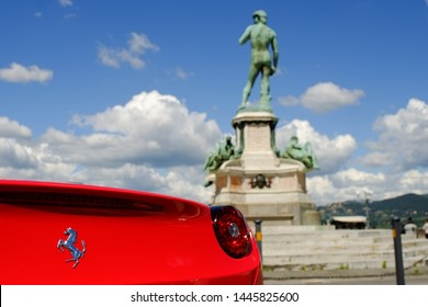 Piazzale Michelangelo, Florence, Tuscany. Italy - circa April 2017 - Red luxury italian Ferrari car parked. Early spring season.