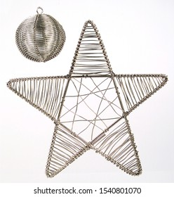 A pic of a silver wired ball and star Christmas tree decorations