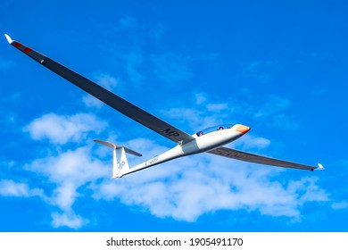 Pic St Loup - France , January 27th 2021 - Glider flying above the mont Pic St Loup mountain on clear day