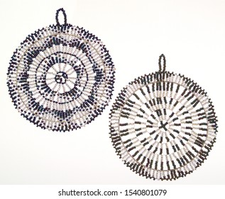 A pic of two round wheels beaded Christmas tree decorations