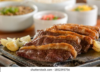 Picanha barbecue roasted on the grill and served in slices