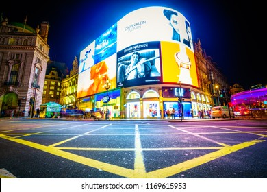 Piccadilly Circus in London at night: LONDON,ENGLAND - AUGUST 16,2018: