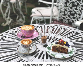 Piccolo latte art coffee cup, latte cup and carrot cake on the vintage table. Choose your cup. Love coffee , wake up and full fill energy. Choose your cup. Vintage style
