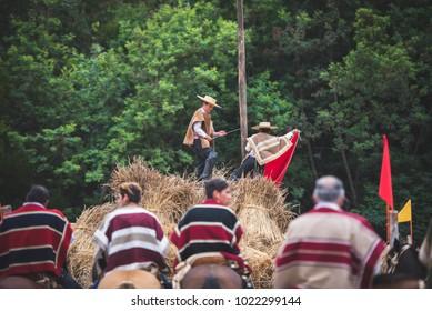 "Pichilemu, Sexta region / Chile - February 03 2018: Traditional chilean huasos on an event called ""Trilla a yegua suelta"". Chilean culture."