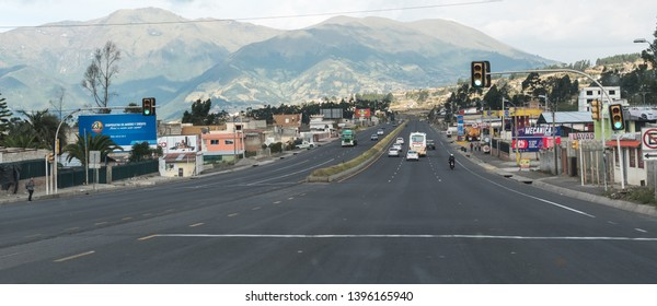 PICHINCHA PROVINCE, ECUADOR - JULY 28, 2018: A wide roadway with multiple lanes and mountains in the background.