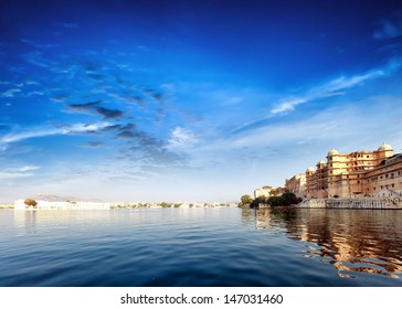 Pichola lake in India Udaipur Rajasthan. Maharajah palace and Taj Lake Palace view. Beautiful panoramic photography of lake water and sky