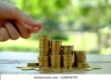Pick up coin over stack of coins