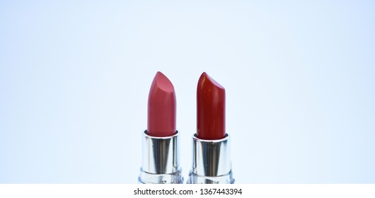 Pick color which suits you. Compare makeup products. Lip care concept. Lipsticks on white background. High quality lipstick. Daily make up. Cosmetics artistry. Lipstick for professional make up.