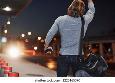 Pick me up please, I must be in airport right now. Young man with bag trying to stop the car because he's late.