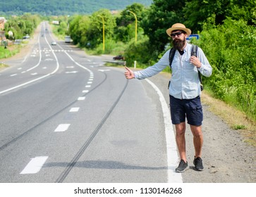 Pick me up. Hitchhiking one of cheapest ways traveling. Picking up hitchhikers. Hitchhikers risk being picked up by someone who is unsafe driver or personally dangerous. Man try stop car thumb up.