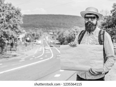 Pick me up. Man bearded hitchhiker stand at edge of road with blank paper sign, copy space. Benefits using sign with name destination. Cardboard sign with indication where you want go.