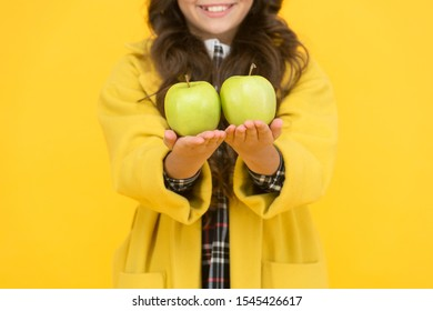 Pick one. Organic natural product. Girl hold apples. Local crops concept. Healthy lifestyle. Eat fruits every day. Child hold apples close up selective focus. Giving apples. Generosity and kindness.