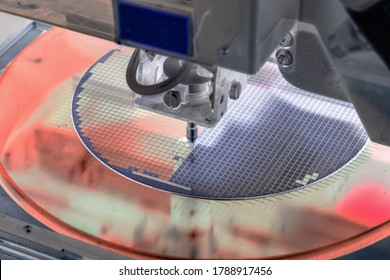 Pick up silicon die in silicon wafer in die attach machine in semiconductor manufacturing/negative color