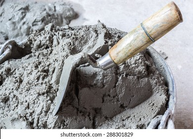 Pick up a trowel and cement mix concrete is compacted sand. Waiting to be mixed with cement