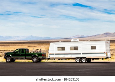 pick up truck  with RV travel trailer on the road