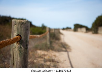 Picket fence on rural path in flight perspective