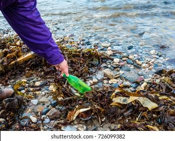 Picking up beach rubbish or Garbage