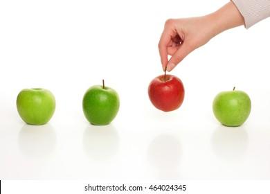 Picking different apple among similar on white