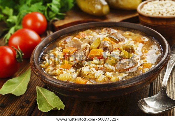 Pickle soup with chicken giblets and tomato sauce. Rassolnik