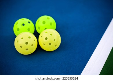 Pickleball balls on a pickle ball court