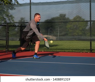 Pickleball is being played outside.