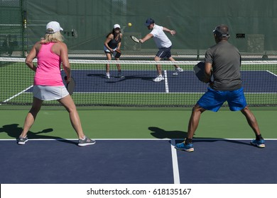Pickleball - Mixed Doubles Action of Colorful Court