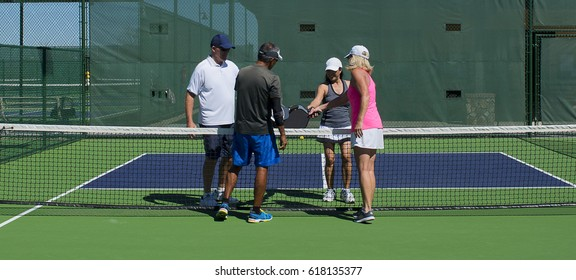 Pickleball - Mixed Doubles Action of Colorful