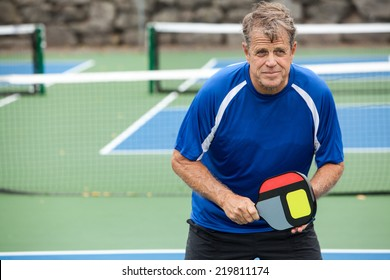 Pickleball player on an outside court