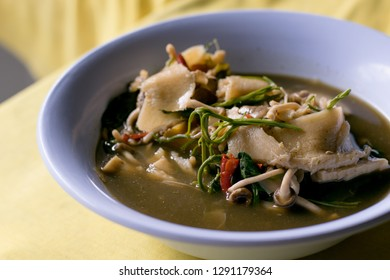 Pickled bamboo shoot with mushroom curry is northeast food of Thailand.