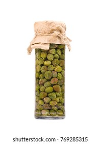 Pickled caper berries in jar isolated on white background. Capers isolated on white background. Pickled capers. Canned capers