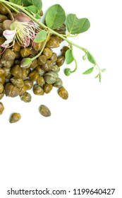 Pickled capers, caper plant and flower on white background