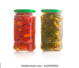 Pickled chili peppers and jalapeno peppers isolated on white background.