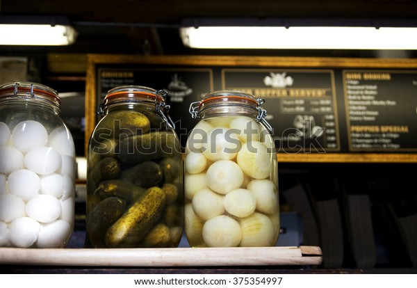 Pickled Eggs, Cucumbers and Onions on a British Fish and Chip shop counter