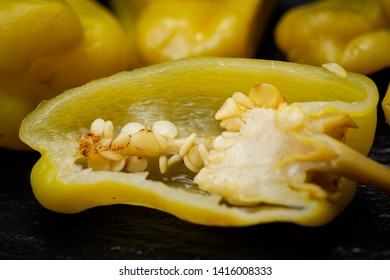 Pickled Golden Greek Peppers, Pepperoncini or Friggitelli (sweet Italian chili pepper) on natural stone background. Capsicum annuum.