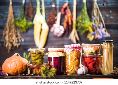 Pickled Marinated Fermented vegetables on shelves in cellar