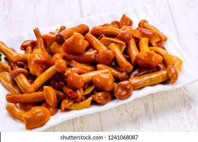 Pickled mushrooms in the bowl with spices