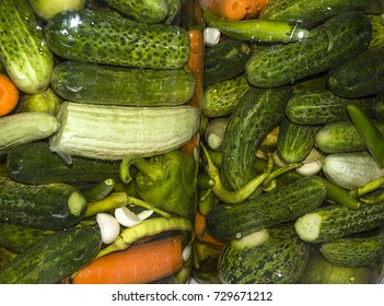 pickled pictures of freshly made pickles, gherkins, peppers, garlic, carrots and rocks, wonderful looking pickle pictures in glass jar