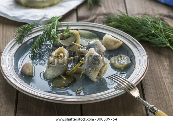 Pickled rollmops herrings with dill